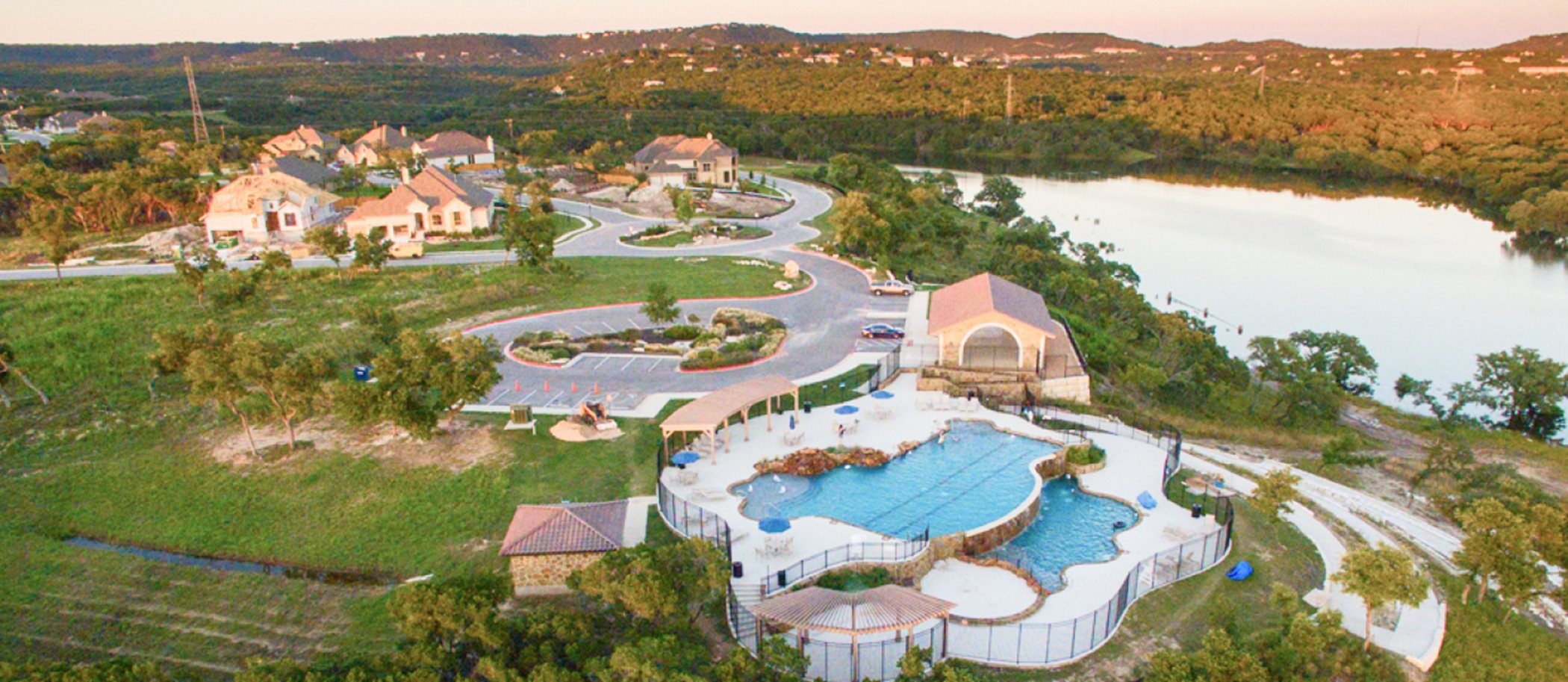Aerial view of Lakeside at Tessera swimming pool and clubhouse
