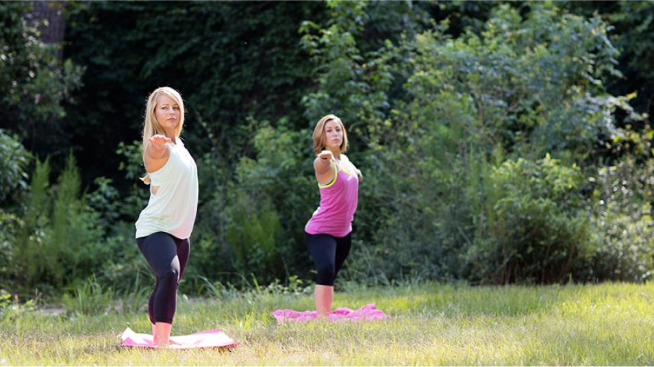 Two people performing yoga