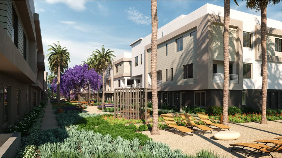 Green space and patio in between townhome buildings