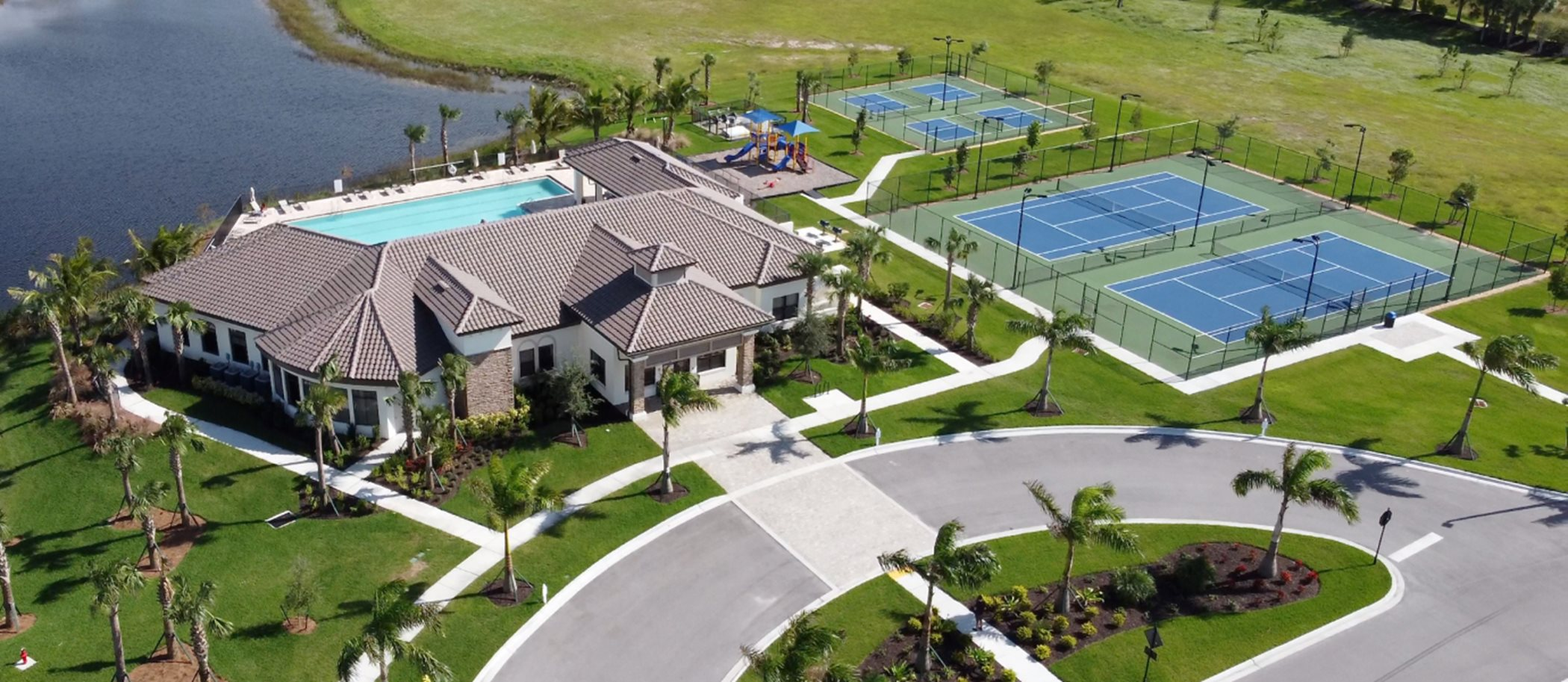 Aerial view of Portico's Clubhouse, Swimming Pool, and Tennis court