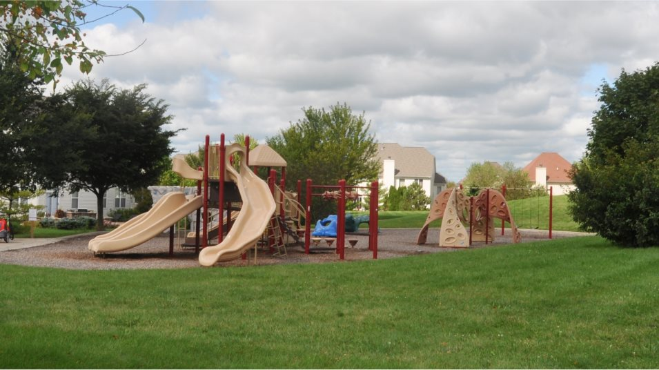 Greywall Club playground multiple slides, a rock wall, swingset